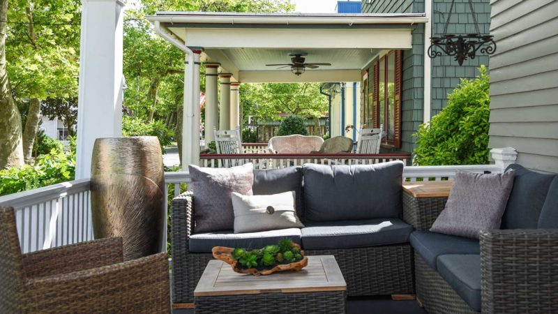Outdoor furniture on a covered porch